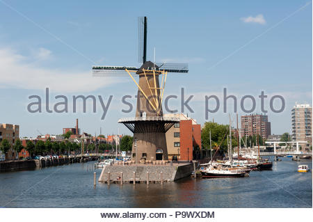 Rotterdam The Netherlands Wind Korenmolen de Distilleerketel windmill, malt mill, on the historical Delfshaven. - Stock Image