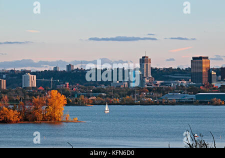 Hamilton waterfront skyline with landmark buildings and harbour at dusk - Stock Image
