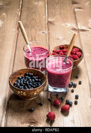 Berry smoothie in glasses . On a wooden background. - Stock Image