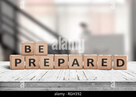 Be prepared phrase on wooden dices in a bright room on an old desk - Stock Image
