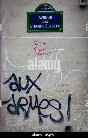 Paris, France. 1st December, 2018. Avenue des Champs-Elysées street sign with 'Call to arms' painted on a wall during the Yellow Vests protest against Macron politic. Credit: Guillaume Louyot/Alamy Live News - Stock Image