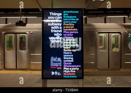 A large electronic sign encouraging people to take public transportation rather than drive. At the Union Square subway station in Manhattan, New York . - Stock Image