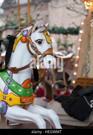 Fairground horses on a carousel in Trier, Germany - Stock Image