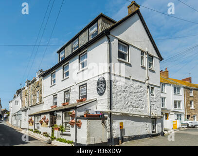 A traditional whitewashed stone guest house near Smeaton's Pier in St Ives, Cornwall, England - Stock Image