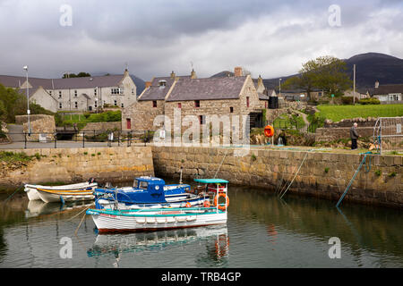 Northern Ireland, Co Down, Annalong, leisure boats moored in harbour by water mill - Stock Image