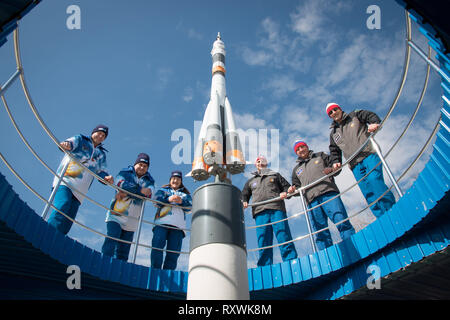 International Space Station Expedition 59 prime and backup crew members pose for a group photo at the Baikonur Cosmodrome March 7, 2019 in Baikonur, Kazakhstan. From left to right are the prime crew members: Nick Hague of NASA, Alexey Ovchinin of Roscosmos and Christina Koch of NASA and the backup crewmembers: Drew Morgan of NASA, Alexander Skvortsov of Roscosmos and Luca Parmitano of the European Space Agency. Expedition 59 crew will launch March 14th onboard the Soyuz MS-12 spacecraft for a six-and-a-half month mission on the International Space Station. - Stock Image