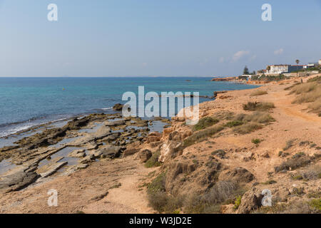 Roman quarry between Mil Palmeras Costa Blanca Spain and Cala de la Lombriz on coast by the sea - Stock Image