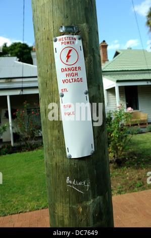'Badwolf' tag below warning tag on light-pole, Perth, Western Australia - Stock Image