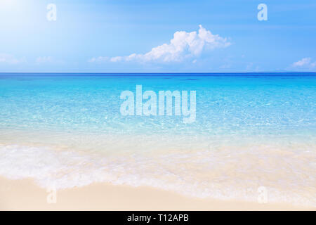 Paradise tropical beach with white sand and clear sea - Stock Image