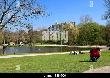 Amsterdam, Netherlands - April 2019; The Vondelpark on a bright spring afternoon. - Stock Image