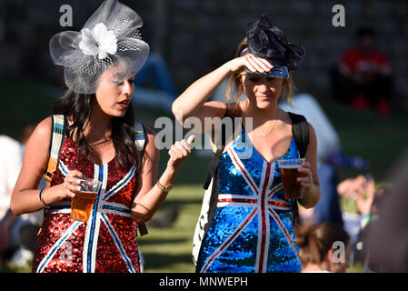 Royal Wedding of Prince Harry and Meghan Markle at Windsor. Girls in Union Jack flag dresses with drinks - Stock Image
