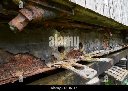 Detail of boiler intake in rusty train car at the abandoned Canfranc International railway station (Canfranc, Pyrenees, Huesca, Aragon, Spain) - Stock Image