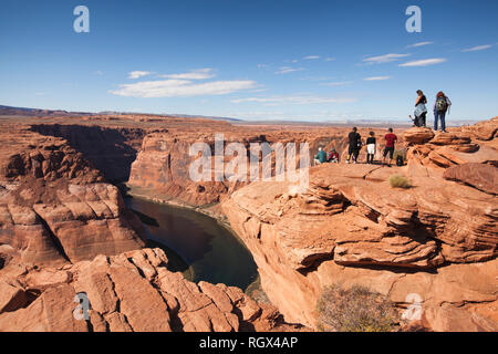 people along the cliffs of Horseshoe Bend in Arizona Page - Stock Image