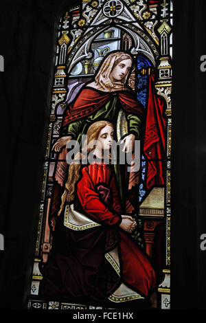 Stained glass window depicting Martha and Mary from the Eponymous Bible Parable, All Saints Church, Beighton, Norfolk - Stock Image