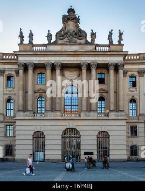 Berlin, Mitte. Humboldt University Law Faculty. Historic old building on Bebelplatz. Exterior facade with columns & sculptures - Stock Image