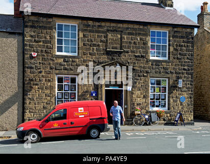 Royal Mail van parked in front of the Old Police Station, Masham, North Yorkshire, England UK - Stock Image