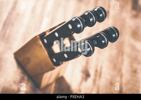 Macro Of A Kitchen Knive Block With 6 Knives On A Table, High Angle View - Stock Image