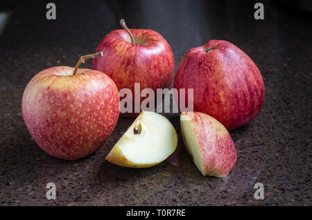 A group of four British-grown ripe red Cameo eating apples ready for eating - Stock Image
