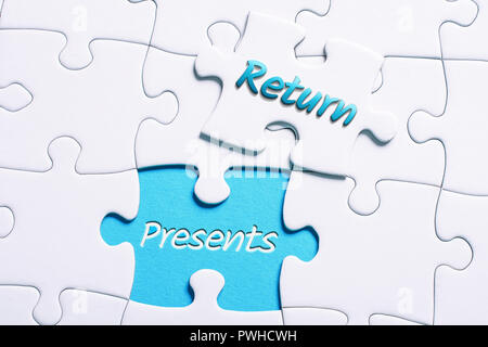 The Words Return And Presents In Missing Piece Jigsaw Puzzle - Stock Image
