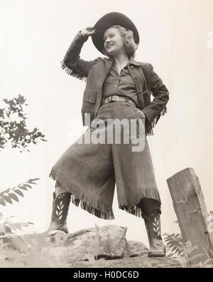 Cowgirl tipping her hat - Stock Image