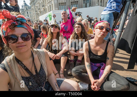London, UK. 19th April 2019.People listen to  Dame Emma Thompson speaking at Extinction Rebellion's Sea of Protest in Oxford Circus around large pink yacht, names after the Honduran environmental activist Berta Cáceres, assassinated in 2016. She came as a part of the activities to show 'Love For The Earth' on the 5th day of the occupation, but which were interrupted by police shortly after she spoke. Credit: Peter Marshall/Alamy Live News - Stock Image