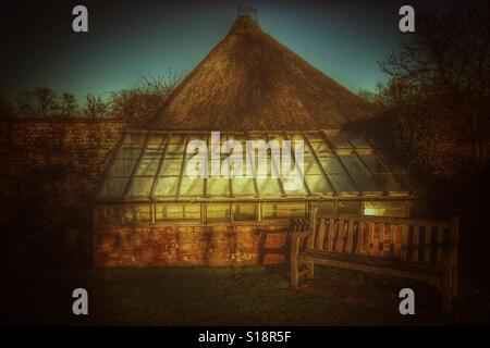 Thatched greenhouse uk - Stock Image