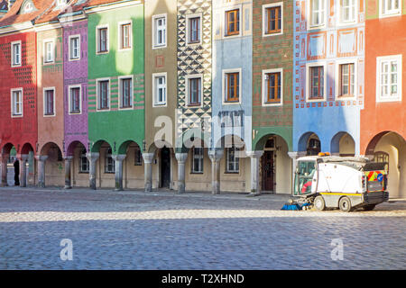 Street cleaning cleaner in the early morning in the old market square in  the Polish city of Poznan Poland - Stock Image