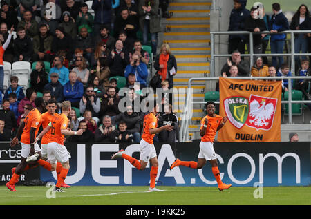 Netherland's Sontje Hansen (right) celebrates scoring his side's first goal during the UEFA European Under-17 Championship final at Tallaght Stadium, Dublin. - Stock Image