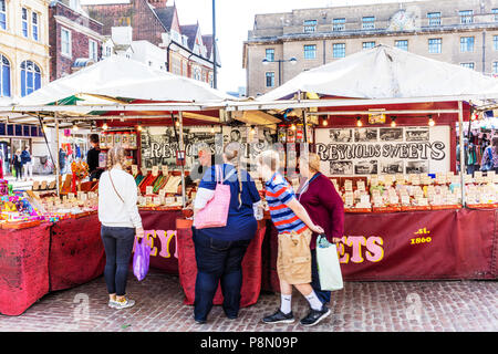 Sweet stall, market stall, sweet market stall, Cambridge market, selling sweets, candy stall, selling candy, sweets, sweet seller, sweet, buying sweet - Stock Image