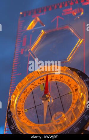 Macro-photo of compass rose face with needle. North direction. Night navigation and  Outward Bound concept. - Stock Image