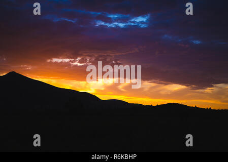 Sunset in mountains. Natural summer landscape - Stock Image