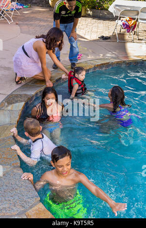 Hispanic children, playing in swimming pool, swimming pool, freshwater swimming pool, Castro Valley, Alameda County, - Stock Image
