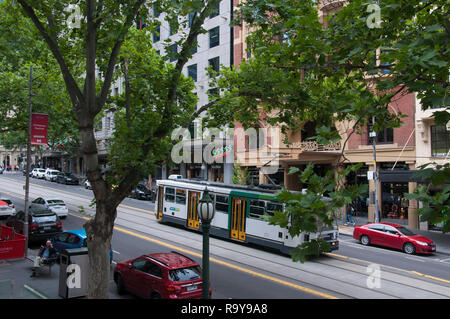 A tramcar heads downhill on prestigious Collins Street, east of Swanston Street, Melbourne, Australia, seen from the Collins Street Baptist Church. - Stock Image