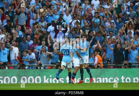 Sergio Aguero of Manchester City celebrates scoring his second goal with Bernardo Silva and John Stones during the FA Community Shield match between Chelsea and Manchester City at Wembley Stadium in London. 05 Aug 2018 - Stock Image