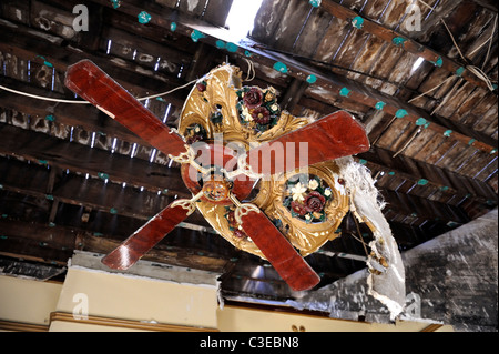 Ornate ceiling fan in building destroyed by arsonist - Stock Image