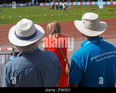 Sheffield, UK. 10th August, 2017. Spectators in sunhats watching athletics at Special Olympics National Games in Sheffield in sunshine Credit: Steve Holroyd/Alamy Live News - Stock Image