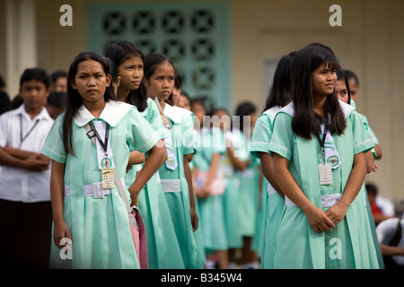 Students line up for the first day of school at Mansalay Catholic High School in Mansalay, Oriental Mindoro, Philippines. - Stock Image