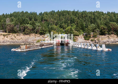 BC Ferries Pender Island ferry terminal at Otter Bay, seen from a ferry leaving the dock. - Stock Image