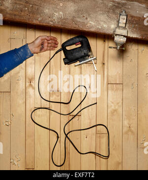 A shot of an accident in a workshop - Stock Image
