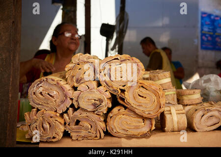 Paiche meat stall in Belem Market, Iquitos, Peru. Paiche, also known as Pirarucu, is one of the largest freshwater fish in the world. - Stock Image
