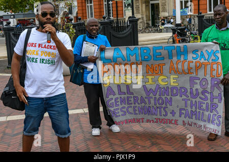 London, UK. 8th September 2018. A Windrush descendant, speaks at the rally before the march in Brixton calling for the Windrush scheme to be widened to include all families and descendants of the Windrush Generation and for an end to the racist hostile environment for all immigrants. It called for an amnesty for those living here without secure immigration status and for free movement for Commonwealth Citizens. Credit: Peter Marshall/Alamy Live News - Stock Image