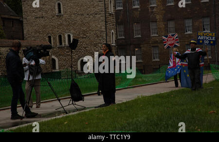 Steve Bray, Mr Stop Brexit, attracting attention from television crew near the Houses of Parliament, London, UK. - Stock Image