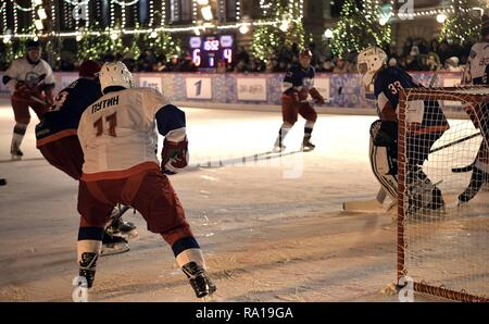 Moscow, Russia. 29th December 2018. Russian President Vladimir Putin #11, left, waits for a shot on goal during ice hockey action at the Night Hockey League match in the rink at the GUM Department store in Red Square December 29, 2018 in Moscow, Russia. Credit: Planetpix/Alamy Live News - Stock Image