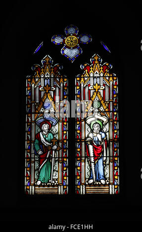 Stained glass window depicting Apostles, St Matthew and St Simon - Stock Image