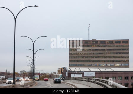 MONTREAL, CANADA - NOVEMBER 9, 2018: North American Highway on Rosemont Boulevard during a cloudy afternoon with cars passing by and a business indust - Stock Image