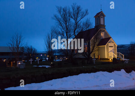A floodlit rural church in an Icelandic village - Stock Image