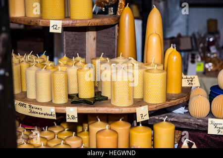 Beeswax candles on sale at a Christmas market stall - Stock Image