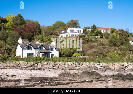 Detached houses overlooking the beach at Rockcliffe, Dumfries and Galloway, Scotland, UK - Stock Image