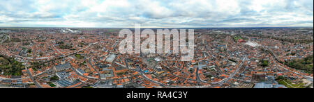 Panoramic aerial view of Bruges from above of historic city is distinguished by its canals, cobbled streets and medieval buildings in Belgium - Stock Image