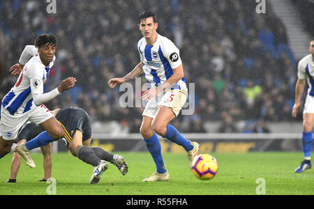 Lewis Dunk of Brighton and Bernardo of Brighton clear the danger during the Premier League match between Brighton and Hove Albion and Leicester City at American Express Community Stadium , Brighton , 24 November 2018 Editorial use only. No merchandising. For Football images FA and Premier League restrictions apply inc. no internet/mobile usage without FAPL license - for details contact Football Dataco - Stock Image